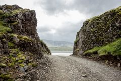 Narrow gravel road between two rocks in Iceland Royalty Free Stock Photography