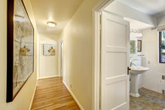 Narrow hallway with exit to bathroom Stock Photo
