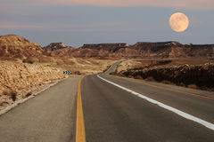 Narrow highway running through desert in Israel. Stock Image