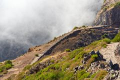 Narrow hiking trails on the mountain Pico do Arieiro. Madeira island. Narrow hiking trails on the mountain Pico do Arieiro. Portuguese island of Madeira royalty free stock image