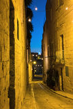 Narrow historic streets of Birgu, or Vittoriosa, in Malta. Narrow historic streets of Birgu, or Vittoriosa, one of the Three Cities in Grand Valetta Bay in Malta Royalty Free Stock Photography