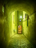 Narrow illuminated alley Stock Photography