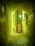 Narrow illuminated alley stock photography