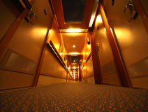 Narrow illuminated corridor in cruise ship Royalty Free Stock Images