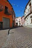 Narrow Italian street. With paving during siesta Stock Photos
