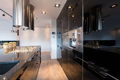 Narrow lacquered kitchen Royalty Free Stock Images