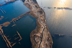 Narrow land edge surrounded by rippling waters, aerial landscape. Industry concept. Narrow land edge surrounded by some rippling waters, aerial landscape stock photography