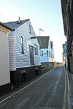 Narrow lane harbour cottages Royalty Free Stock Images
