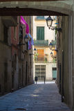 A narrow lane with lanterns in the center of Gothic Quarter of Barcelona. Catalonia, Spain Stock Image
