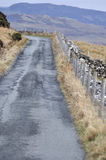 Narrow lane on the Isle of Skye. Narrow lane leading up or coming down - just feel the spirit of the Isle of Skye at the beginning of March and waiting for stock photo