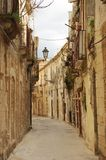 A narrow lane in Italy. A narrow lane in the old town of Syracuse, Sicily Stock Photo
