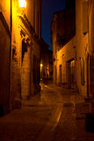 Narrow lanes in Uzes France by night. Narrow streets in the medievalin the medieval town of Uzes in Lanuedoc France. Originally a Roman city. today its a cool Royalty Free Stock Images