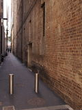 Narrow laneway between commercial buildings Stock Image
