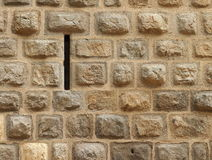 Narrow loophole in old stone wall Royalty Free Stock Photos