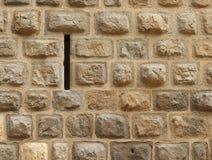 Narrow loophole in old stone wall. Narrow loophole in very old stone wall in the facade of a medieval castle Zvikov (Czech republic royalty free stock photos
