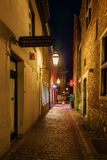 Narrow medieval alley in the old town of Aachen, Germany, at night stock photos