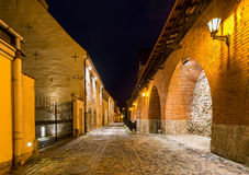 Narrow medieval street with ancient fortress wall, night photo in old Riga city, Latvia Stock Photography