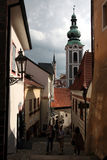 Narrow medieval street in Cesky Krumlov, Czech Republic. Stock Photos
