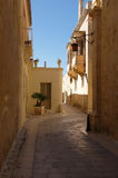 Narrow medieval street in Medina, Malta stock photo