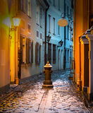 Narrow medieval street in old city of Riga, Latvia Stock Photo