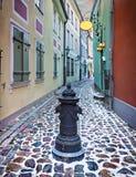 Narrow medieval street in the old city of Riga, Latvia. Stock Photo