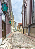 Narrow medieval street in old city of Riga, Latvia Royalty Free Stock Photos