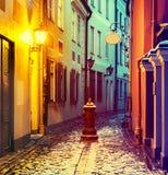 Narrow medieval street in old Riga city, Latvia Royalty Free Stock Image