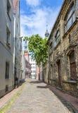 Narrow medieval street in old Riga city, Latvia Stock Photography