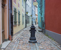 Narrow medieval street in the old Riga city, Latvia Royalty Free Stock Photos