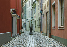 Narrow medieval street in the old Riga city, Latvia. Stock Images