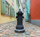 Narrow medieval street in the old Riga city, Latvia Stock Photography