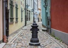 Narrow medieval street in old Riga, Latvia Stock Photos