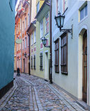 Narrow medieval street in old Riga, Latvia Royalty Free Stock Images