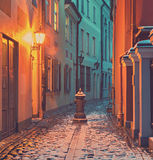 Narrow medieval street in old Riga, Latvia Stock Images