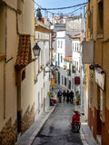 Narrow medieval street in Old Sitges, historical resort-city clo Royalty Free Stock Image