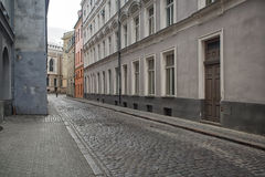 Narrow medieval street in old town of Riga city Royalty Free Stock Images