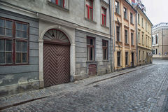 Narrow medieval street in old town of Riga city Stock Photos