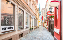 Narrow medieval street in old town Riga. Royalty Free Stock Image