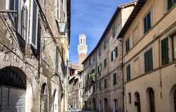 Narrow medieval street in Siena, Italy Royalty Free Stock Photos
