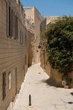 Narrow medieval street with stone houses in Mdina, Malta Royalty Free Stock Photo