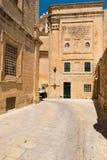 Narrow medieval street with stone houses in Mdina, Malta Royalty Free Stock Photos