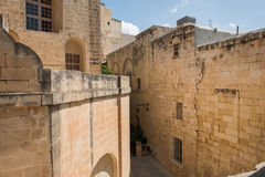 Narrow medieval street with stone houses in Mdina, Malta Royalty Free Stock Photography