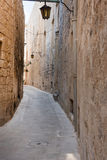 Narrow medieval street with stone houses in Mdina, Malta Royalty Free Stock Image