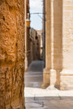 Narrow medieval street with stone houses in Mdina, Malta Stock Image