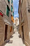 Narrow medieval street in Trogir, Croatia Royalty Free Stock Image