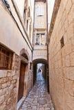 Narrow medieval street in Trogir, Croatia Royalty Free Stock Images
