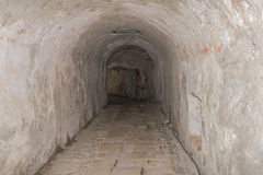 Narrow medieval tunnel made of bricks Royalty Free Stock Images