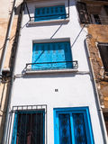 Narrow Mediterranean house facade Stock Photo