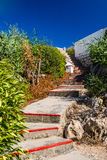 Narrow mediterranean stairs path. With nature bush and rocks. Shoot in Turkey close to Kemer Royalty Free Stock Image
