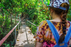 Narrow metal bridge and walkway in tropical forest Royalty Free Stock Photography